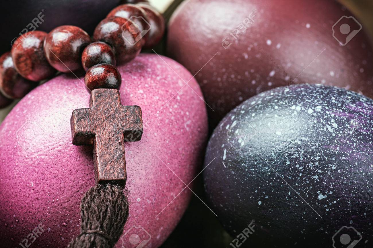 Dyed Easter Eggs And Religious Christian Symbols On A Wooden Stock