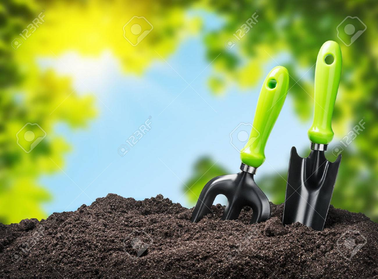 tools garden soil on nature background. Focus on tools - 37297841