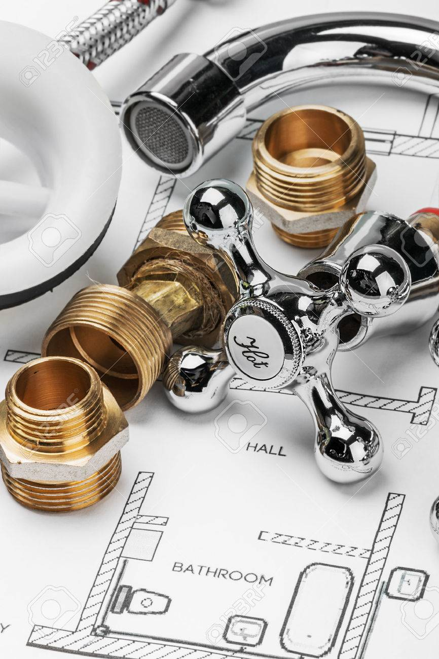 plumbing and tools lying on drawing for repair - 37298286