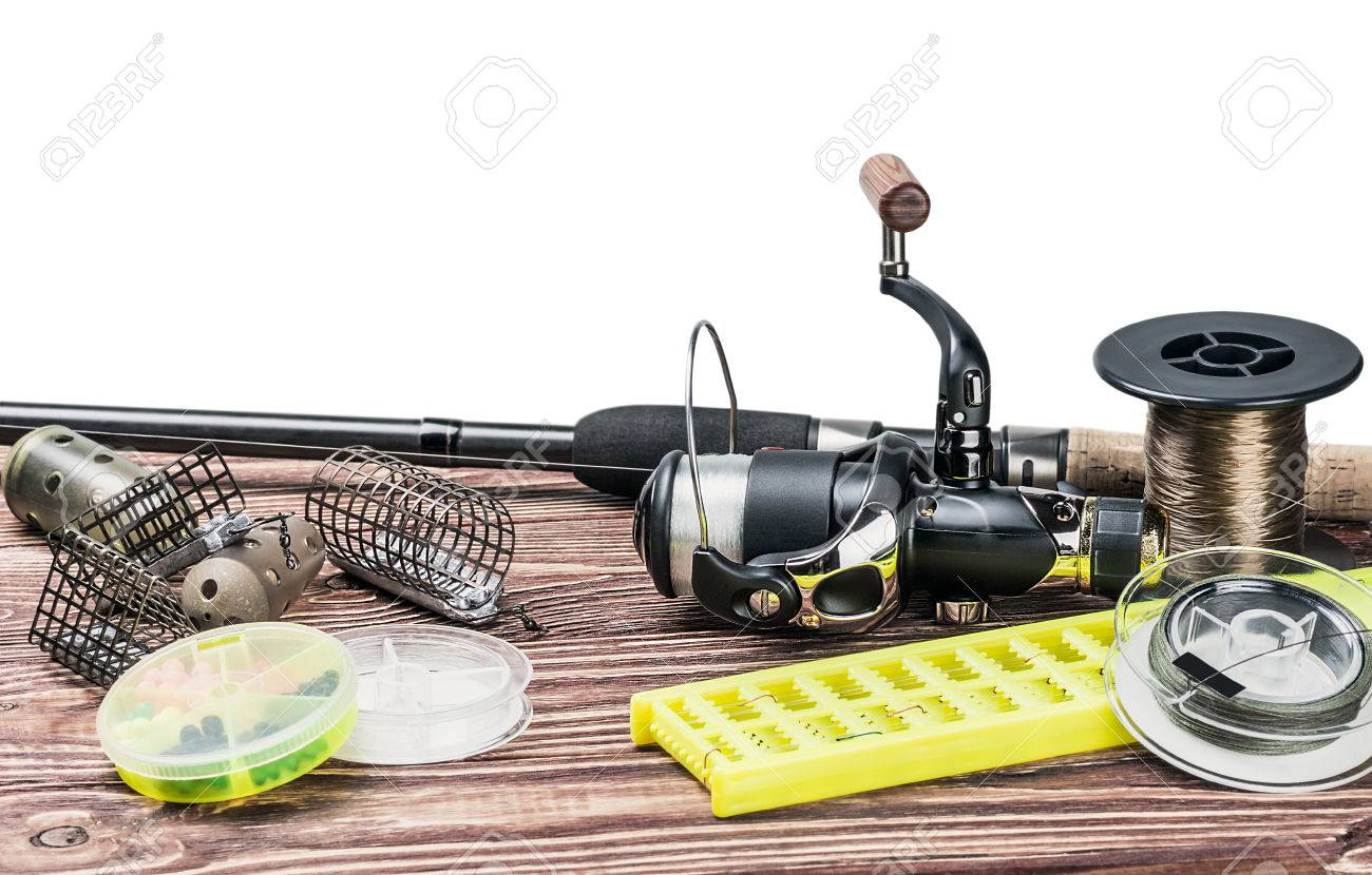 fishing tackle on a wooden table isolated on a white background - 38305574