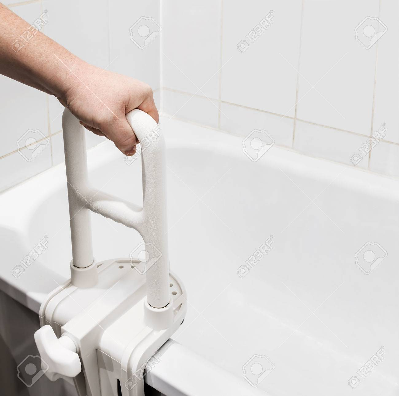 Hand Holding The Handrail In The Bathroom. Focus On The Handrail Stock  Photo   43166897
