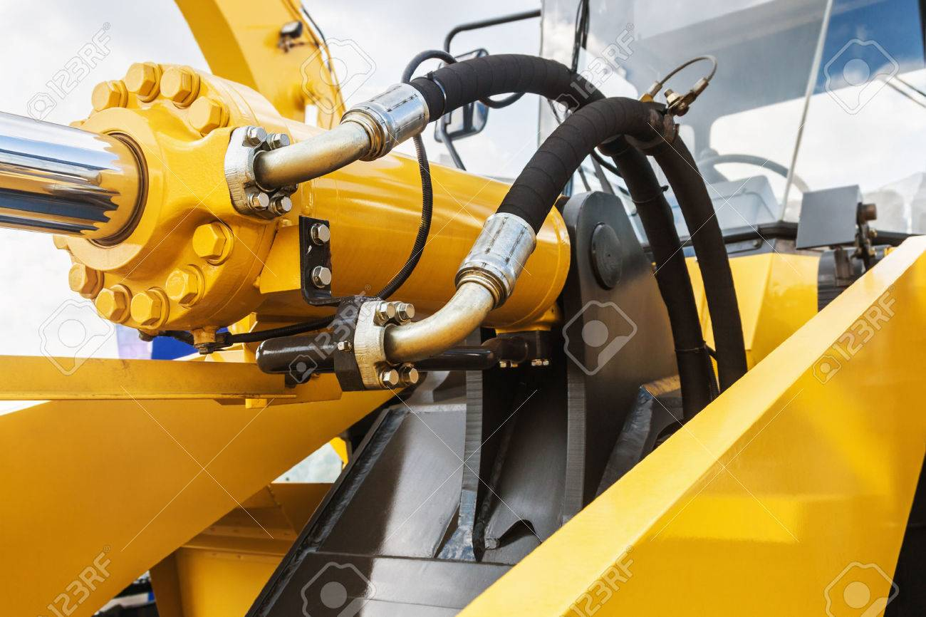 hydraulics tractor yellow. focus on the hydraulic pipes - 61682508