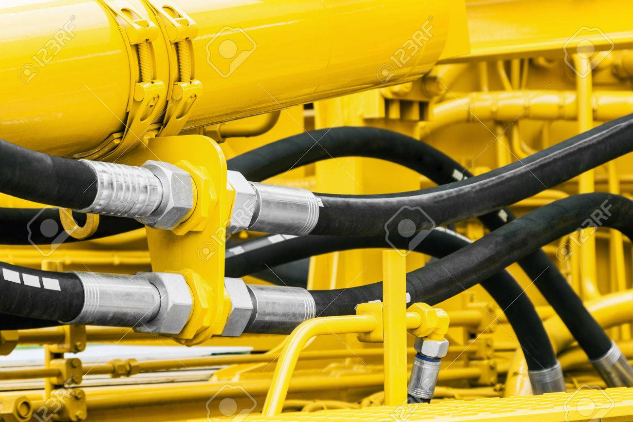 hydraulics pipes and nozzles, tractor or other construction equipment. focus on the hydraulic pipes - 80027371
