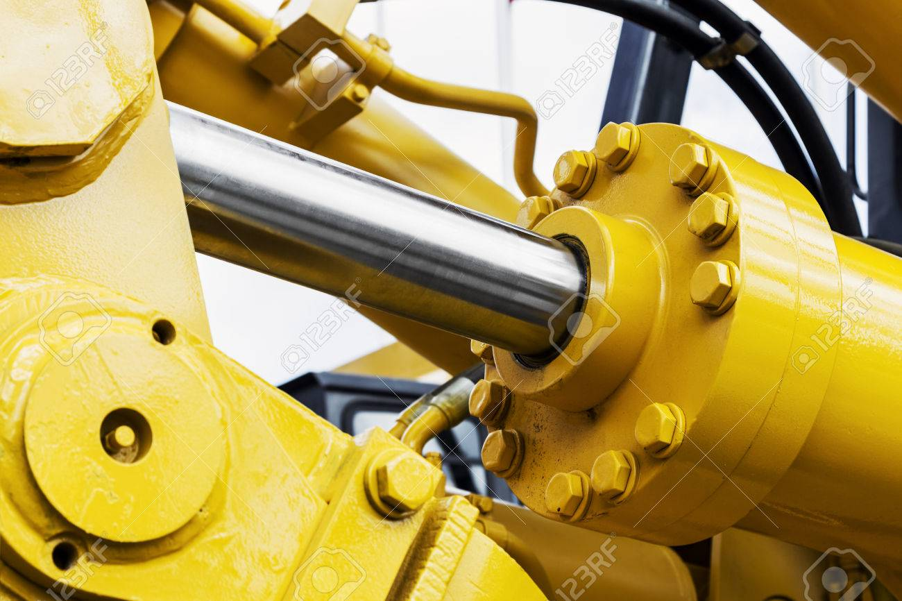 hydraulics tractor yellow. focus on the hydraulic pipes - 81259703