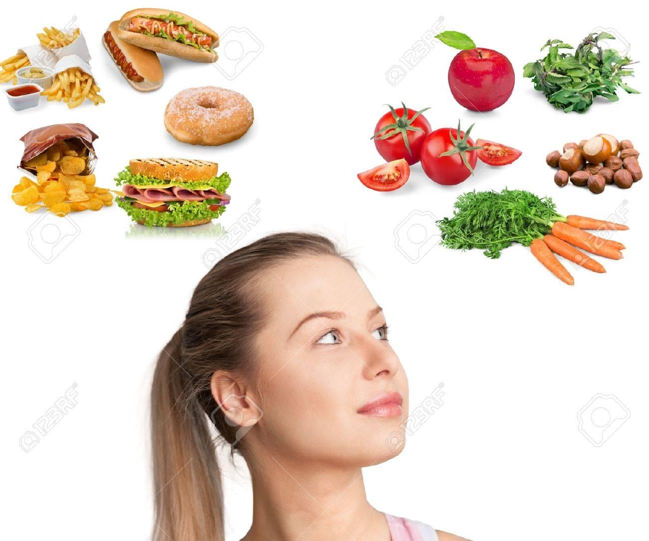 Food, junk, women. Stock Photo - 42370520