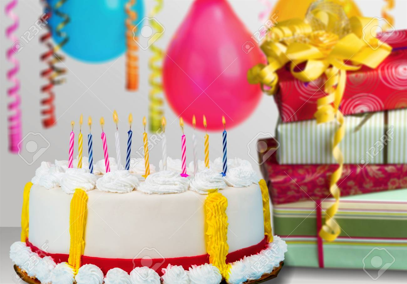 Blue Birthday Cake Presents Hats And Colorful Balloons Over Light Grey Stock Photo