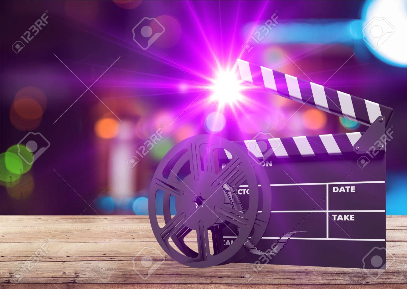 Film Movie Background Clapperboard And Film Reels In Theater Stock