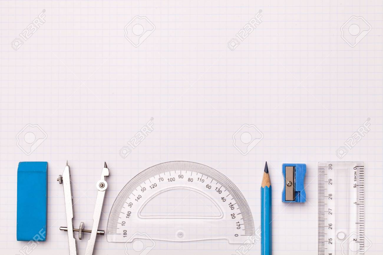 mathematical instruments surrounding a graph paper creating copy