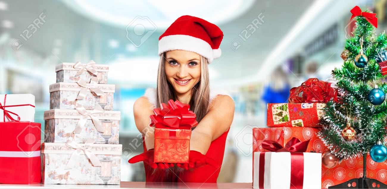 5a3938aec332e Beauty Christmas fashion model girl holding Xmas gift box. Beautiful lady