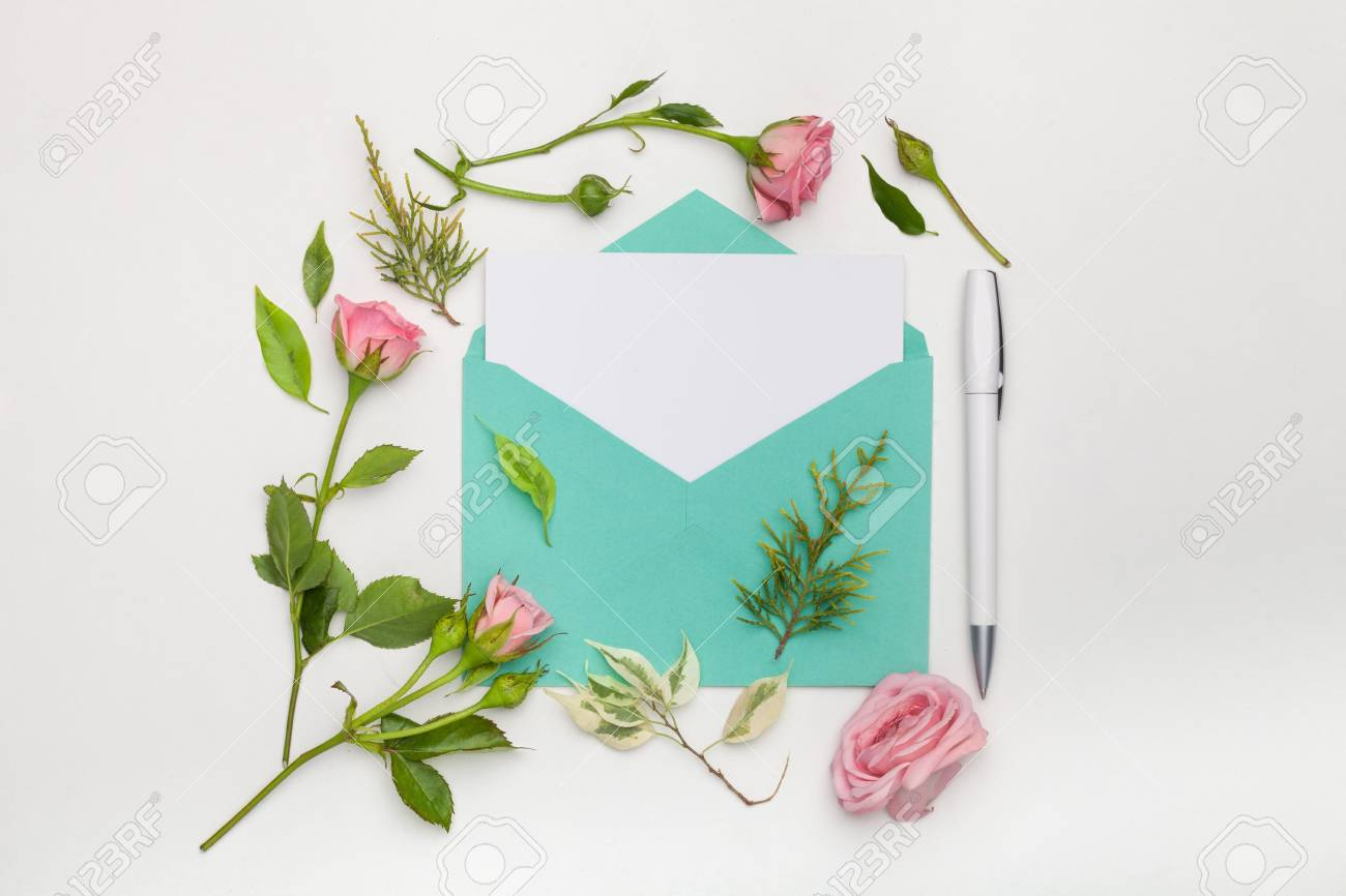 Flat Lay Shot Of Letter And Eco Paper Envelope On White Background