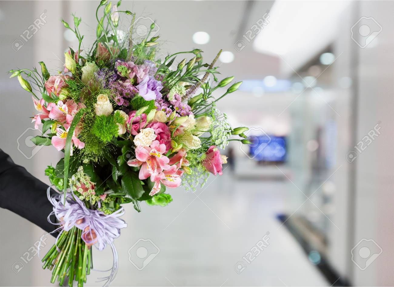 hand giving a flower bouquet stock photo picture and royalty free