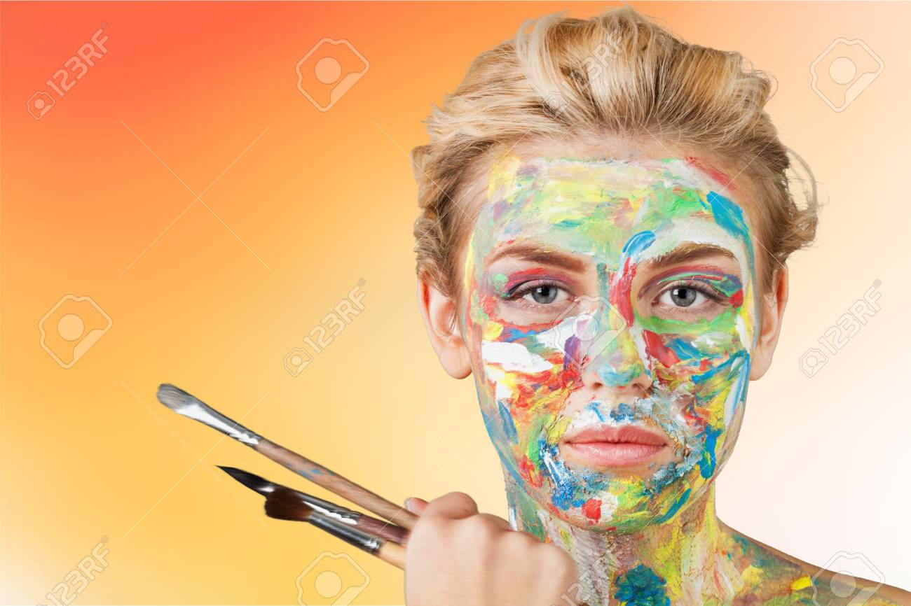 Woman artist with paint face - 108236637