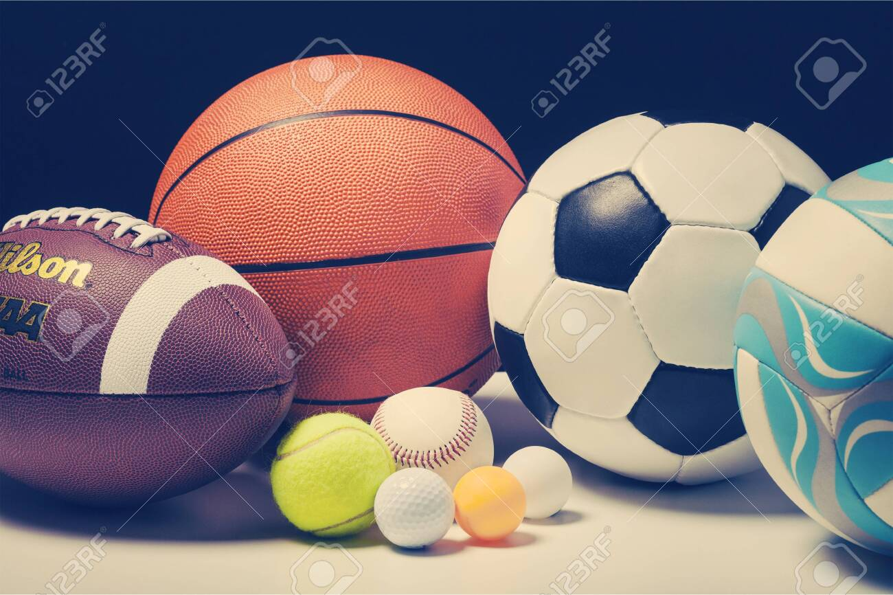Set of balls for different sports on white table background - 133261000