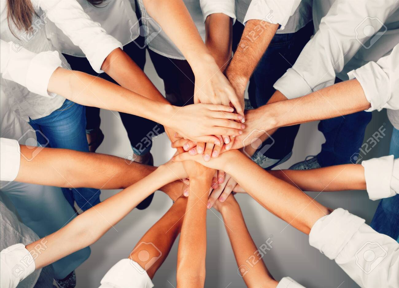 Group of people stacking hands together - 123949868