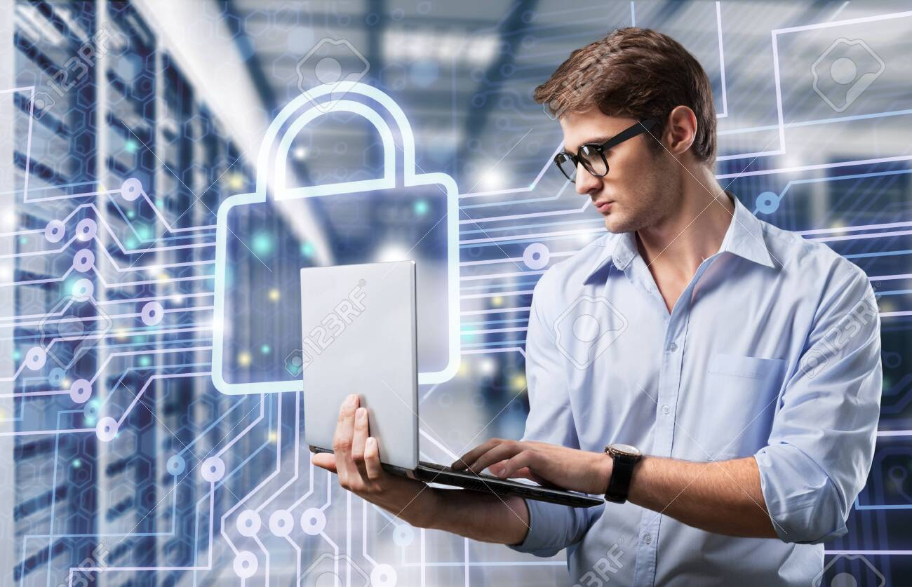 young it engeneer business man with thin modern aluminium laptop in network server room - 124269465