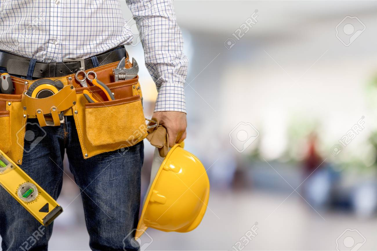 Worker in a construction site - 124674414