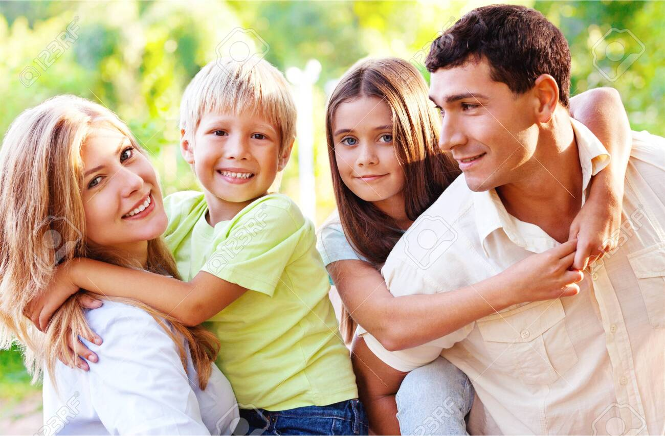 Beautiful smiling Lovely family on background - 124300253