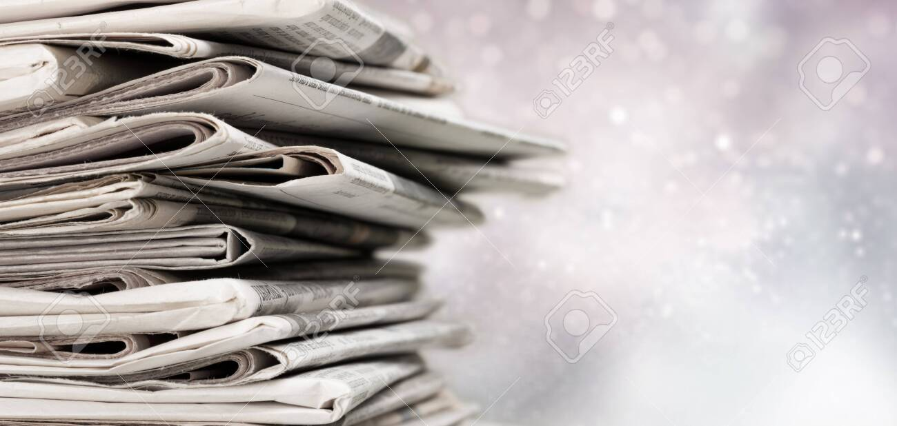 Pile of printed newspapers on background - 124467125