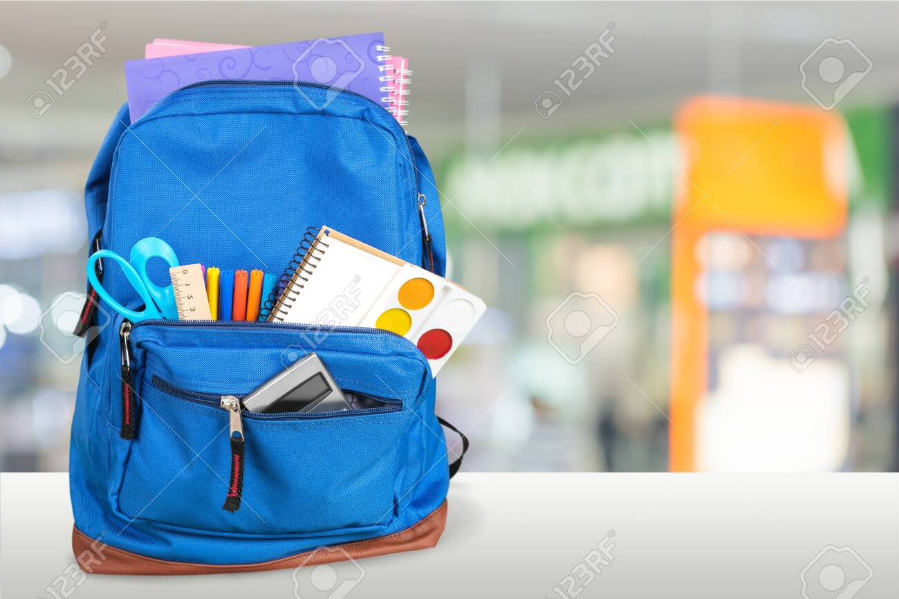School Backpack with stationery on wooden table - 124465414