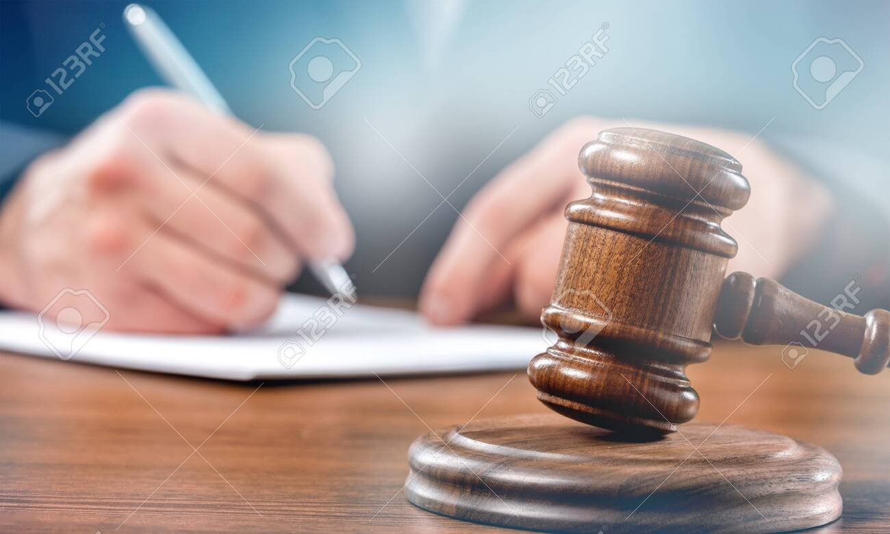 Close up gavel judge with lawyer working at courtroom. - 124464415