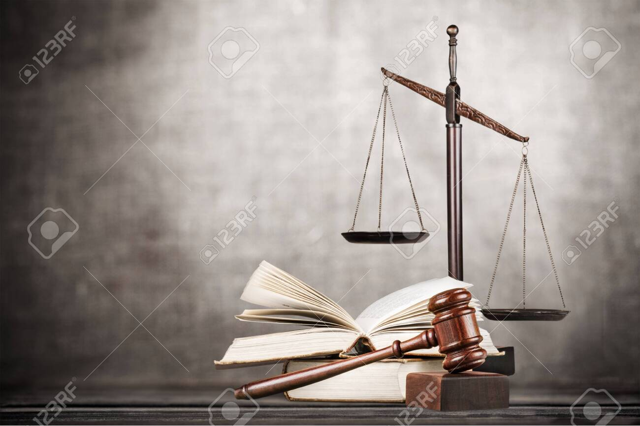 Law scales on table background. Symbol of - 124452588