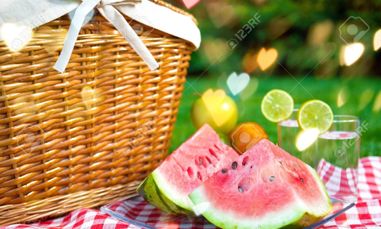 Picnic basket with watermelon on nature - 124315976