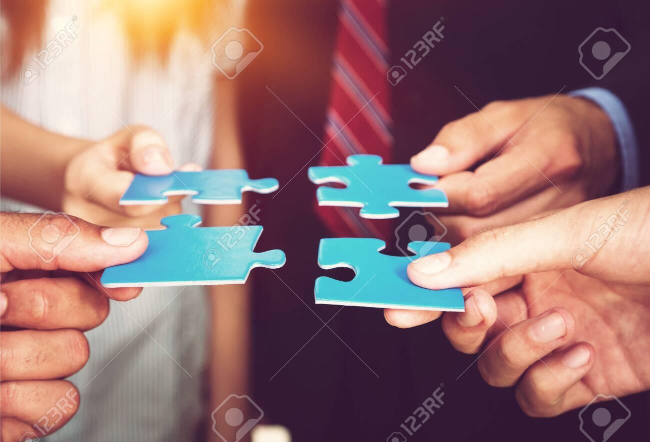 Business people holding puzzle pieces. problem solution concept - 124316455