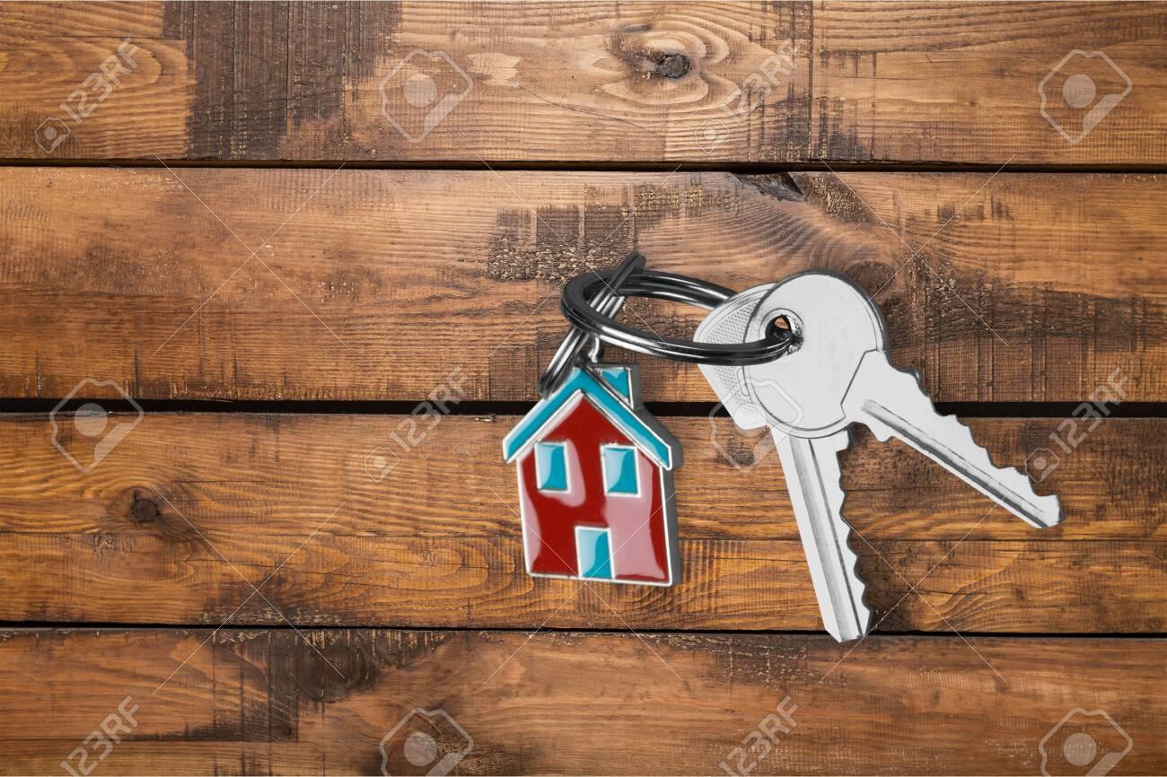 House keys on wooden floor background - 125141810