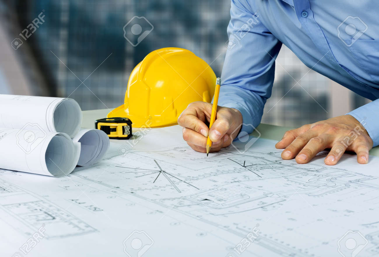Architect sketching a construction project - 125156029