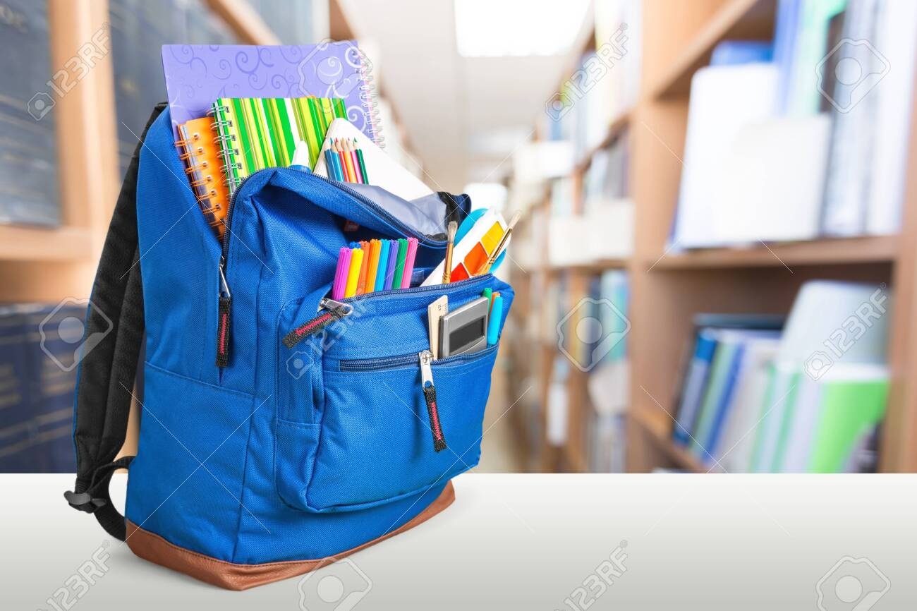 School Backpack with stationery on wooden table - 127184340