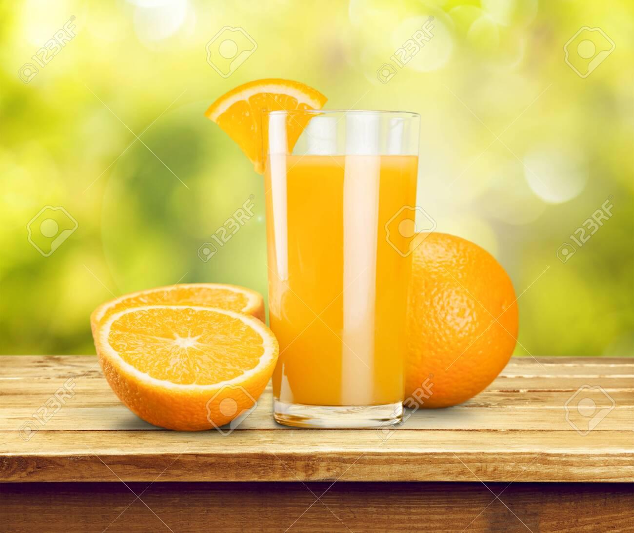 Orange juice and slices of orange on background - 127187070