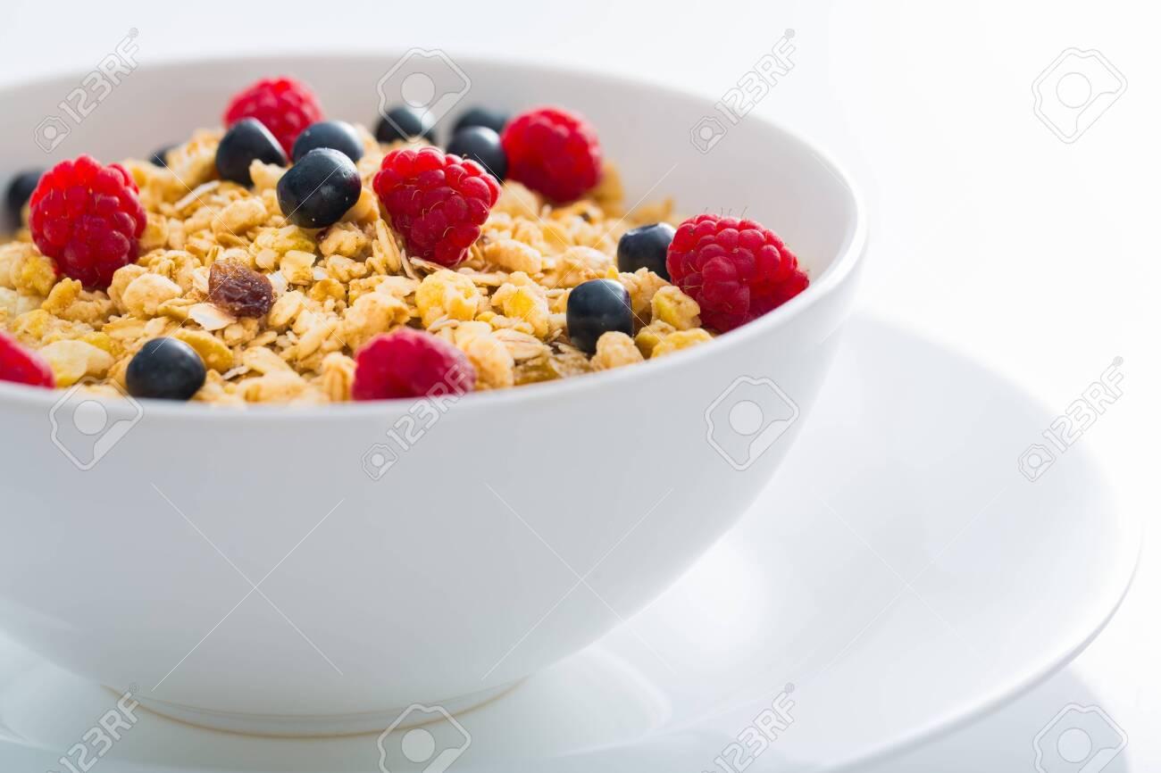 Bowl of Granola, Blueberries and Raspberries - 127187555