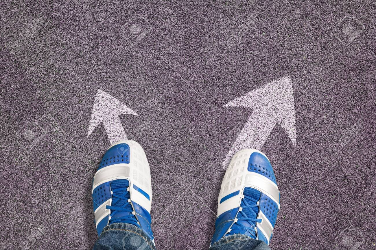 Shoes on the asphalt road with drawn arrow - 128032219