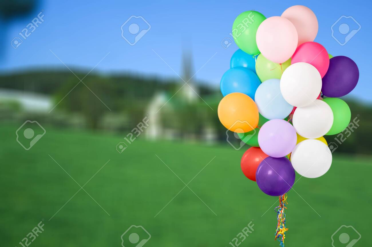 Bunch of colorful balloons on white background - 128530312