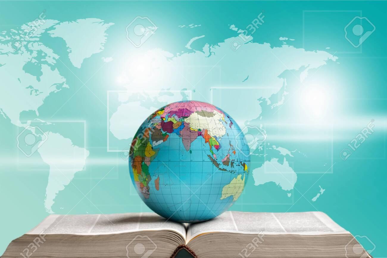 Globe on open book - 128522546