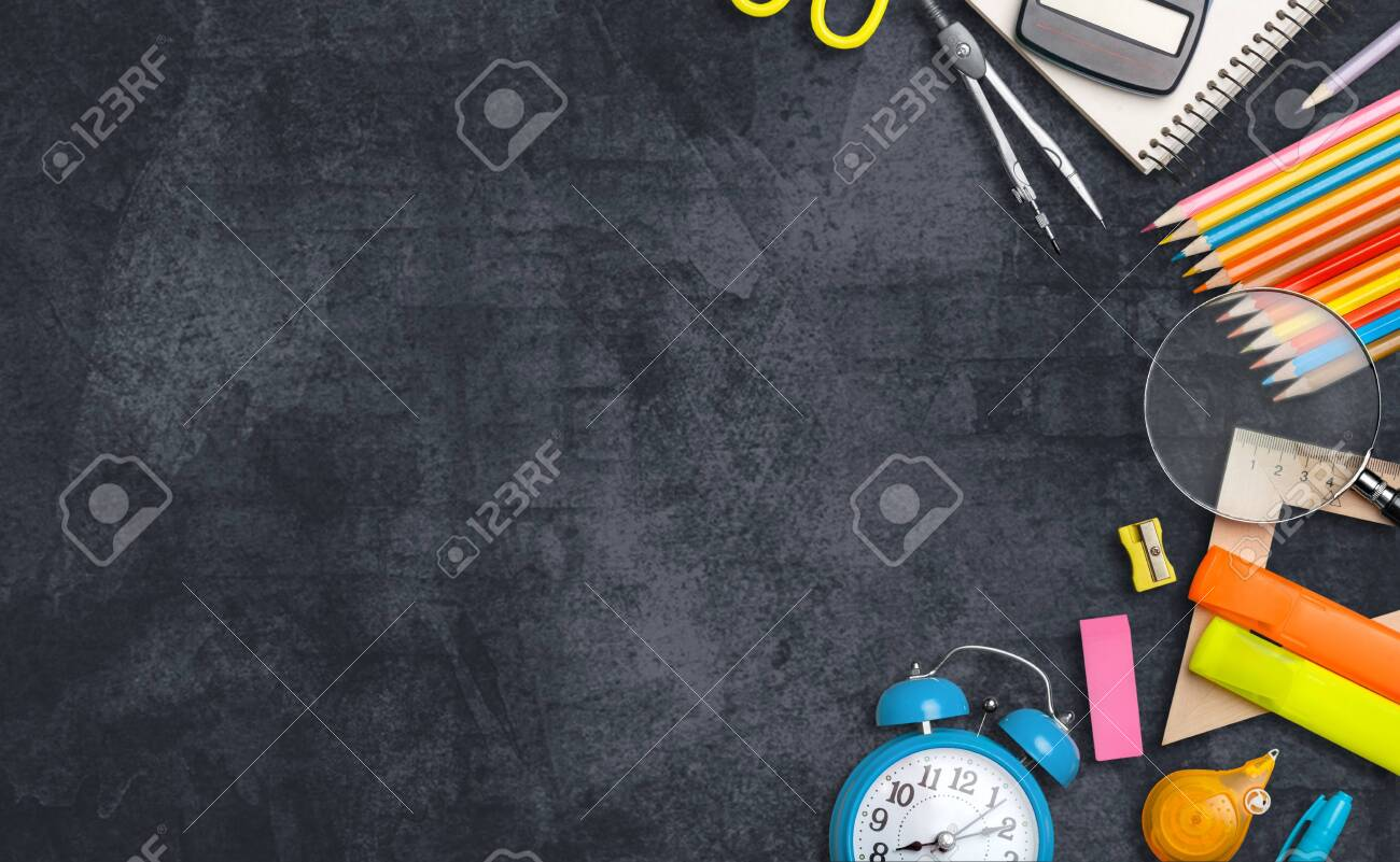 School supplies on black board background. Back to school concept - 128901978