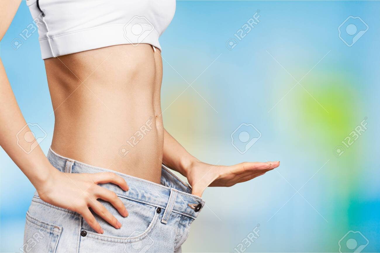 Young woman showing waist. weight loss concept - 131882807
