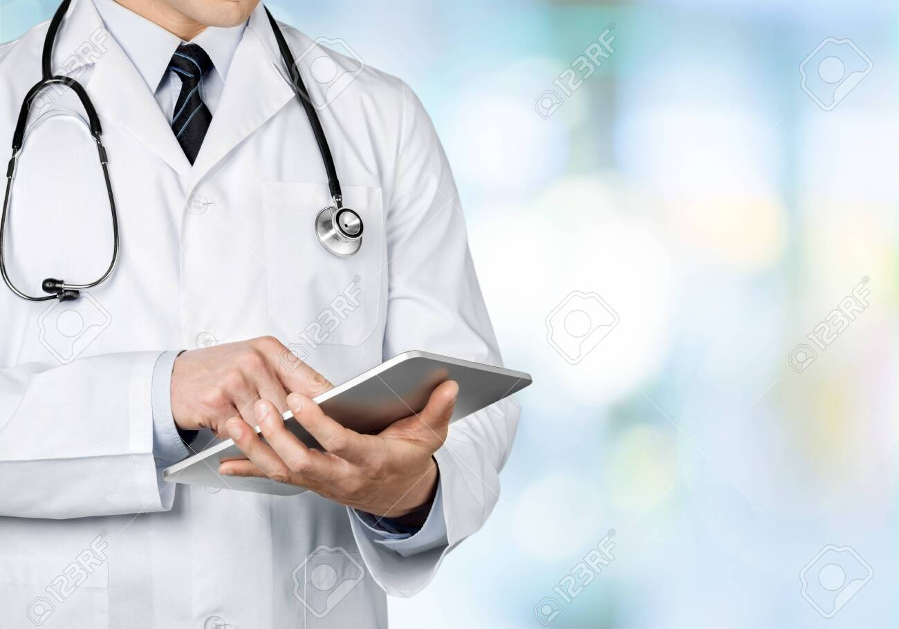Close-up Doctor at hospital working with tablet pc - 129160712
