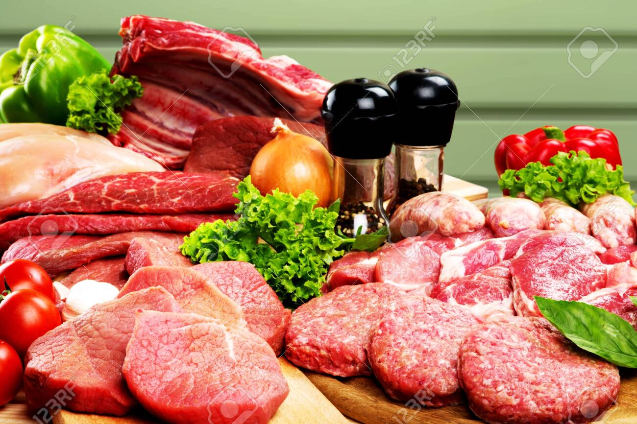 Fresh Raw Meat Background with vegetables - 129160931