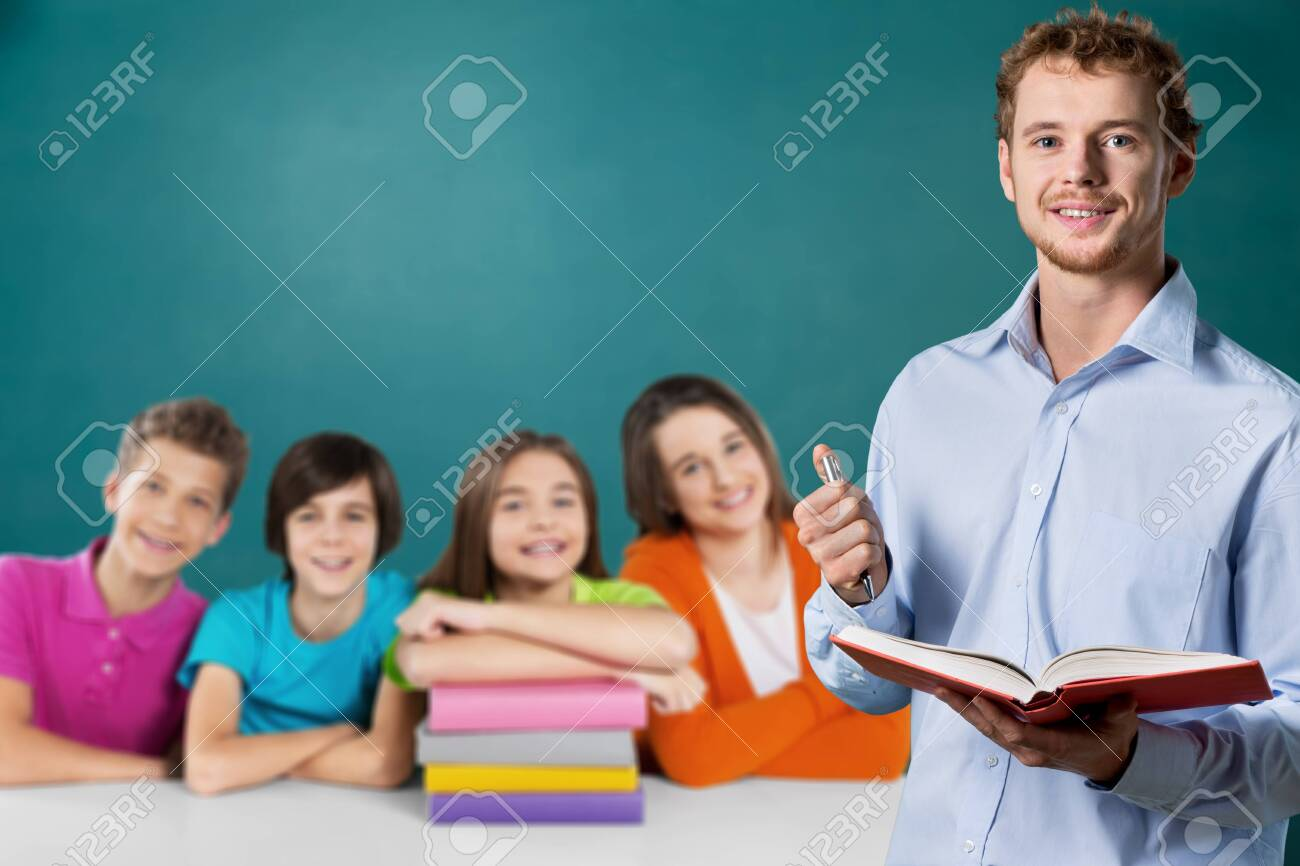 Young male teacher and school child - 129160597