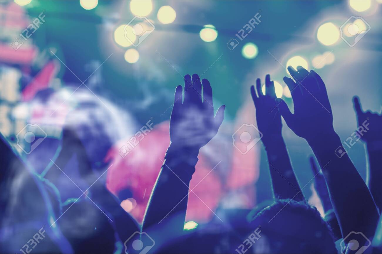 Audience with hands raised at a music - 129161187