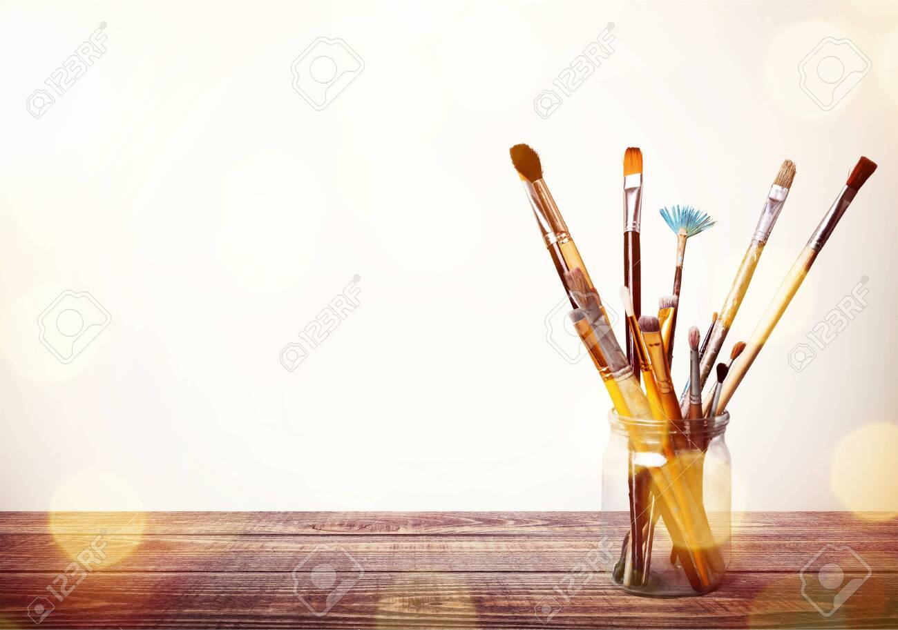 Brushes in a glass jar - 129160956