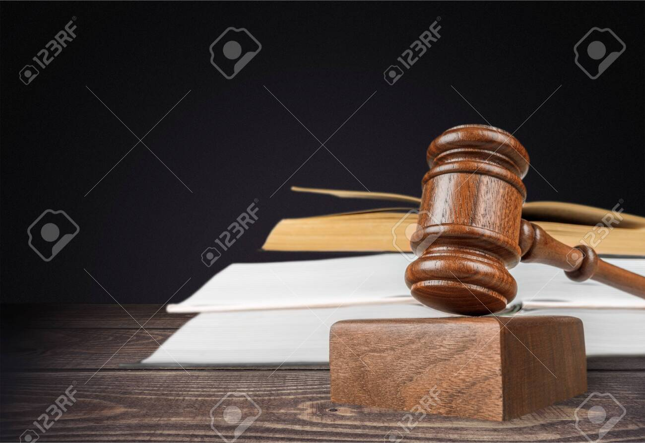 Books and wooden gavel on table. Justice concept - 130154210