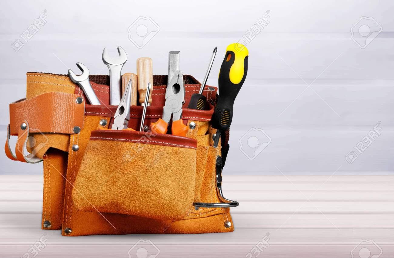 Tool belt with tools on desk - 133626464