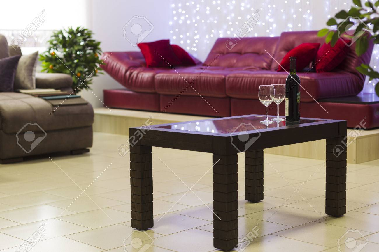 Groovy Bottle Of Wine With A Glass On The Coffee Table On A Background Gamerscity Chair Design For Home Gamerscityorg