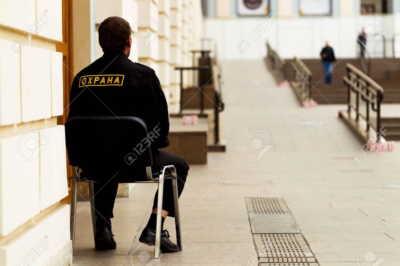 door keeper: Security guard sitting on a chair at the door inside the room & Door Keeper Images \u0026 Stock Pictures. Royalty Free Door Keeper ... Pezcame.Com