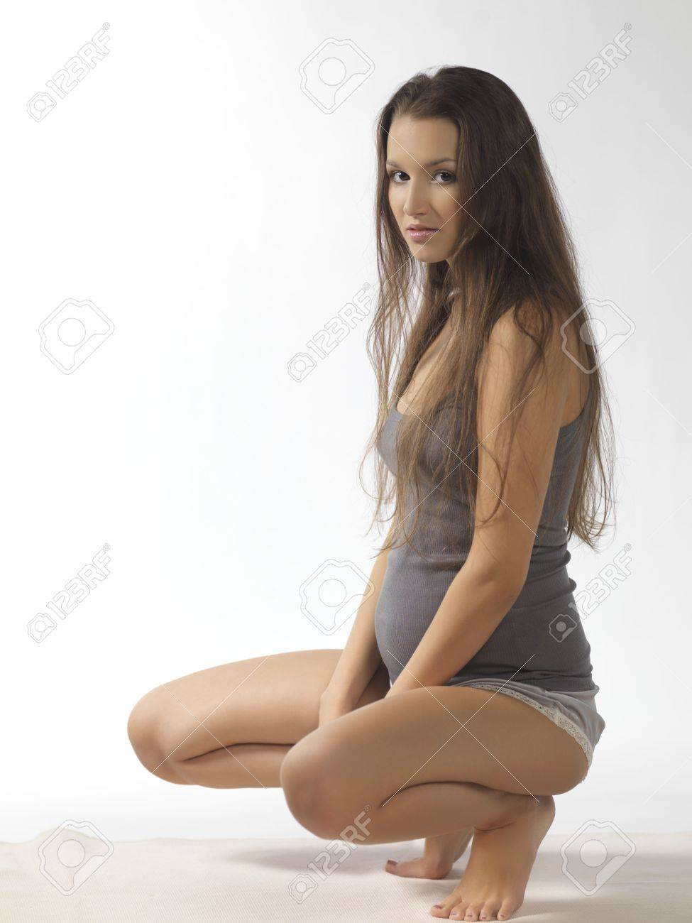 Young pregnant Stock Photo - Young and pregnant woman