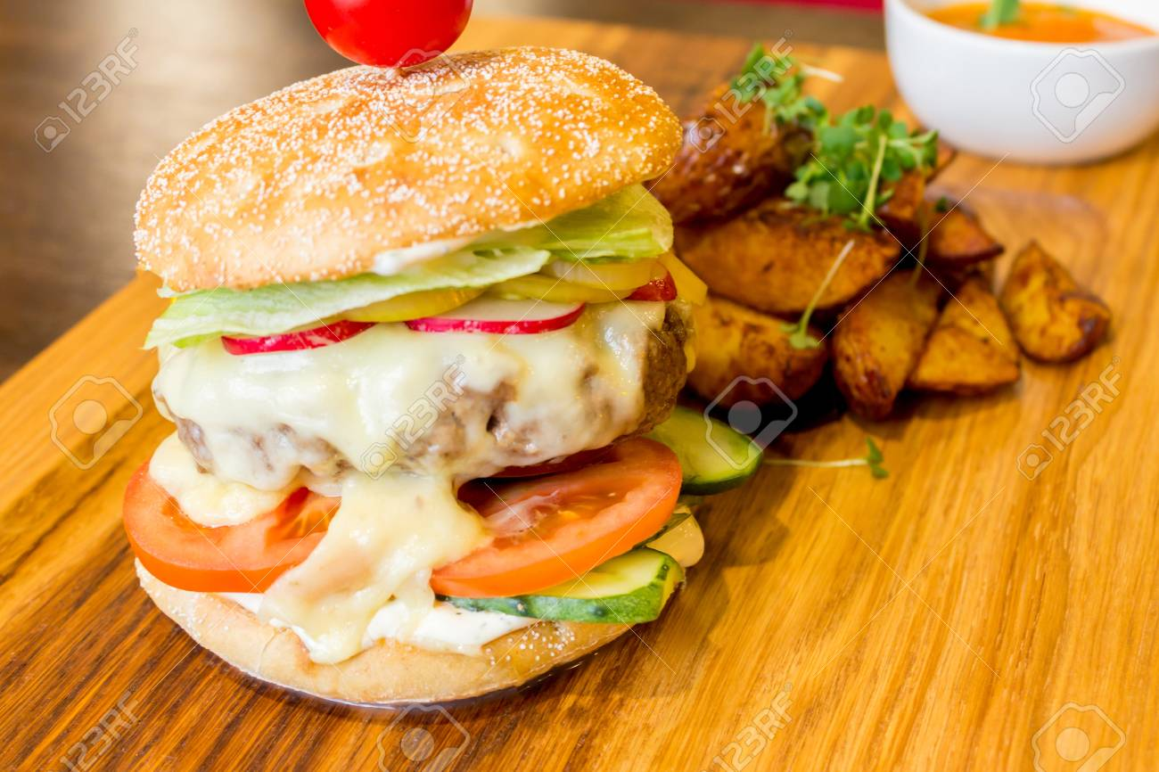 Delicious Burger With Meat Vegetables Potatoes And Orange Sauce Stock Photo Picture And Royalty Free Image Image 102244887