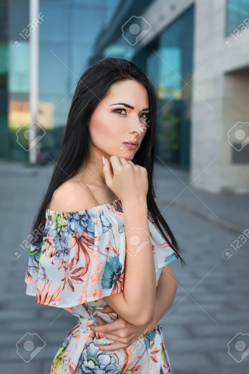 Young Thoughtfull Beautiful Brunette Woman With Long Hair In Stock