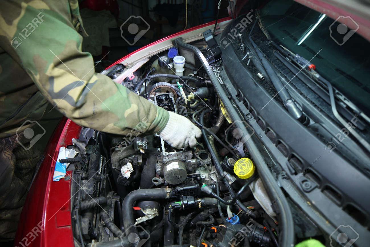 engine repair in a car garage servic - 139605285